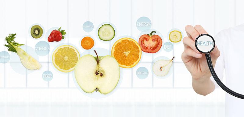 Pomme, fruits, légumes et stéthoscope